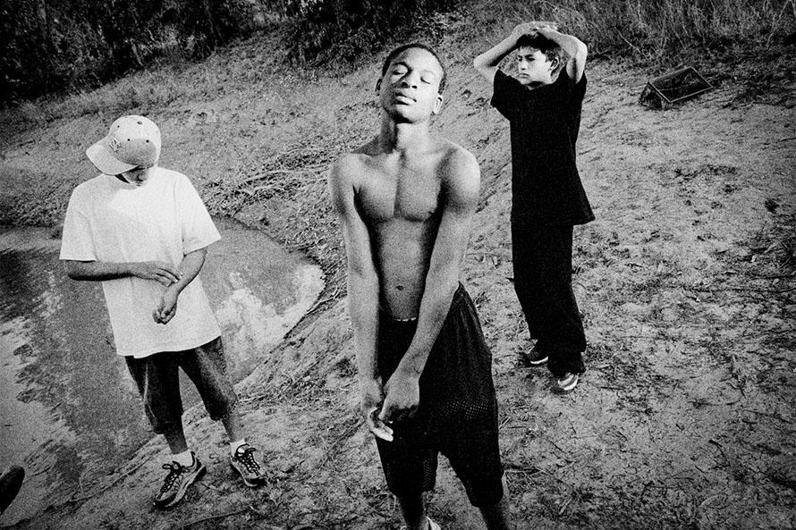 Matt Black - Teviston, California. Kids at an irrigation pond.