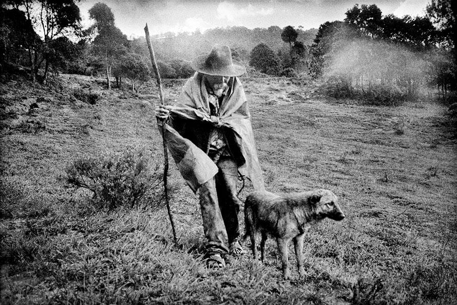 Matt Black - San Miguel Cuevas, Mexico. A man returns home from his remote cornfield.